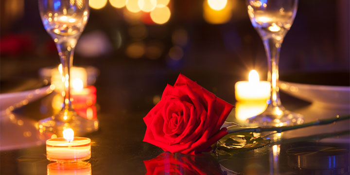 Red rose on a table in a romantic setting